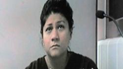 Madre de niño muerto aparece en corte por asaltar a familiar