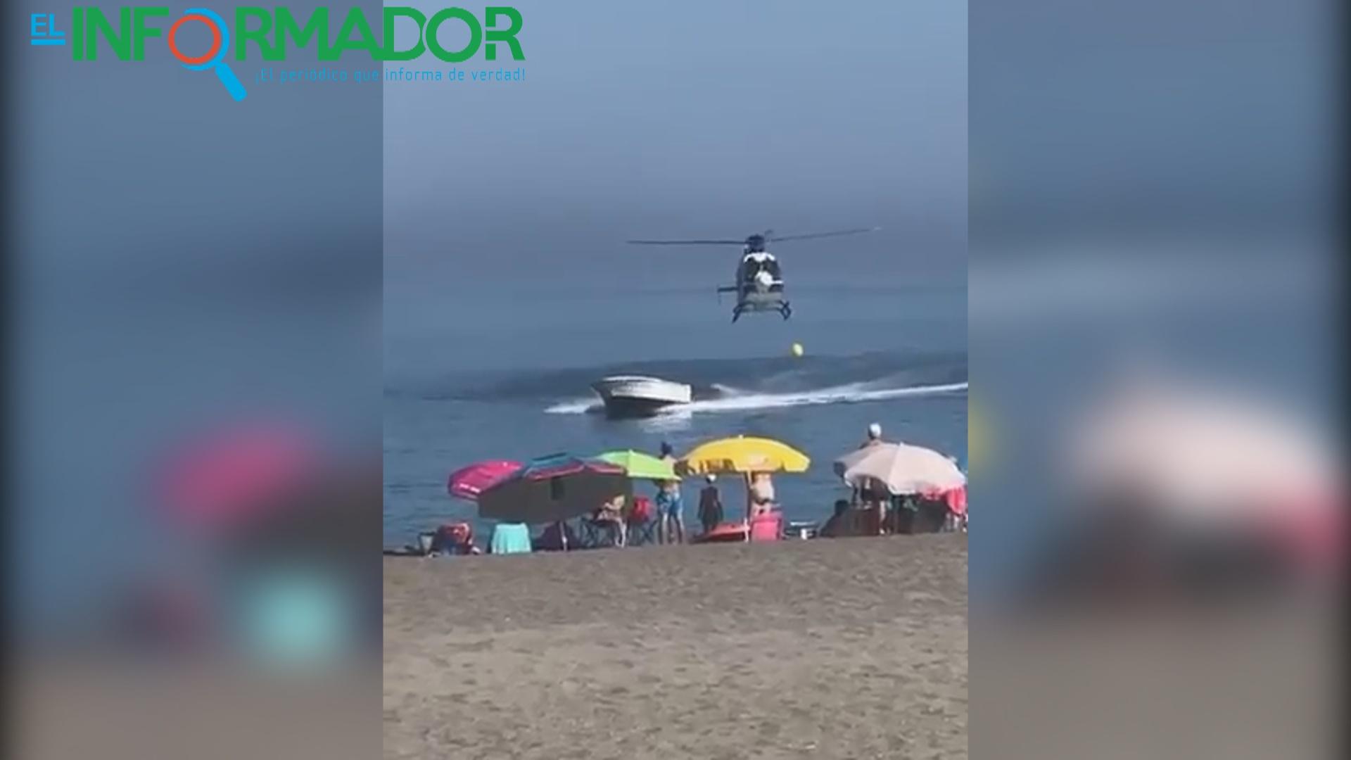 VIDEO: 'Narcolancha' perseguida por un helicóptero de la policía sorprende a bañistas en España